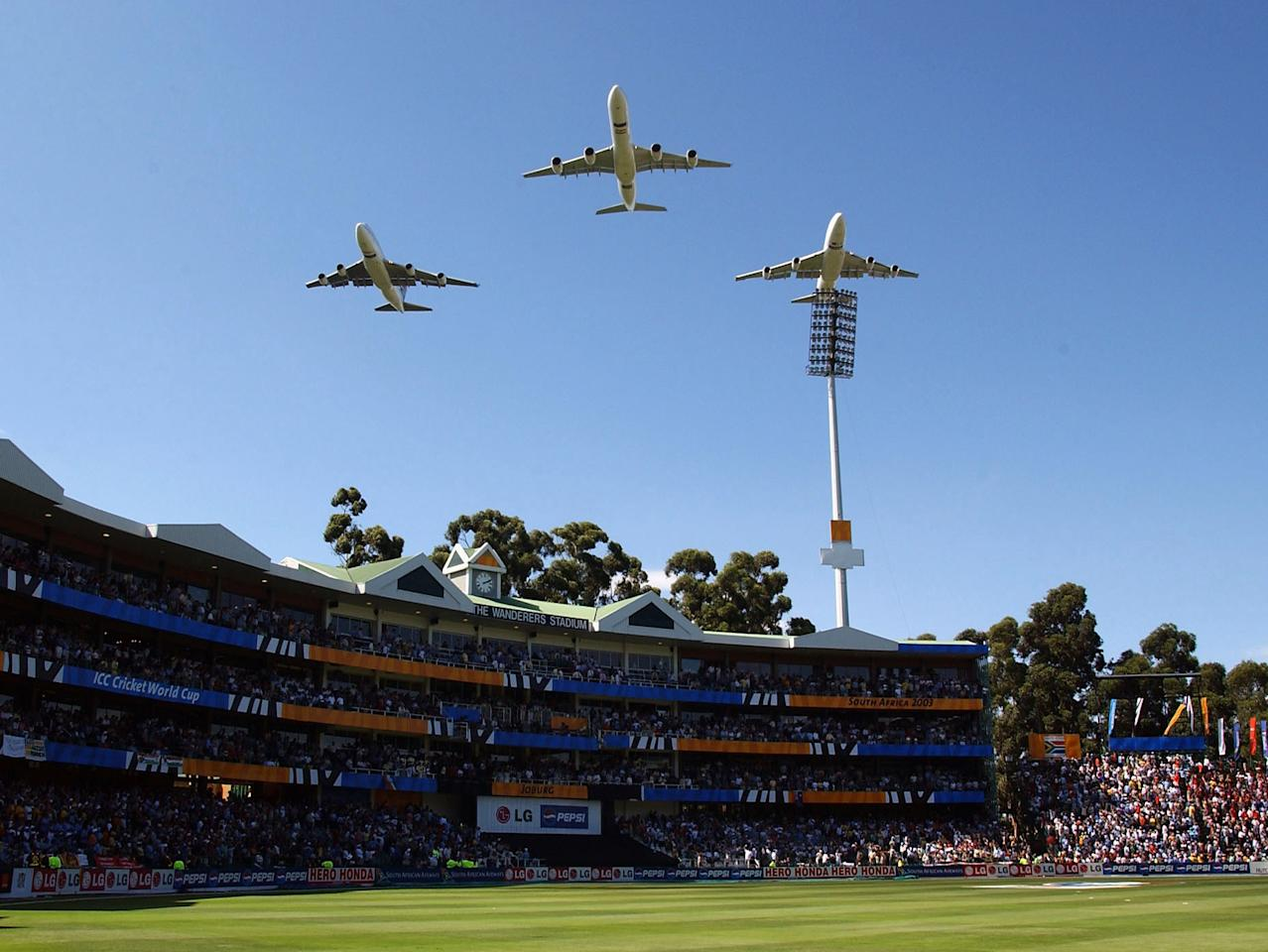 JOHANNESBURG- MARCH 23:  South African jets fly over the stadium during the World Cup Final between Australia and India at The Wanderers Ground Johannesburg, March 23, 2003. (Photo by Stu Forster/Getty Images).