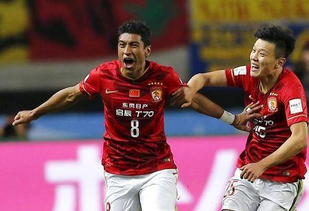Paulinho (L) of China's Guangzhou Evergrande celebrates with teammate Zou Zheng after scoring against Mexico's Club America during their Club World Cup quarter-final soccer match in Osaka, western Japan, December 13, 2015.  REUTERS/Thomas Peter