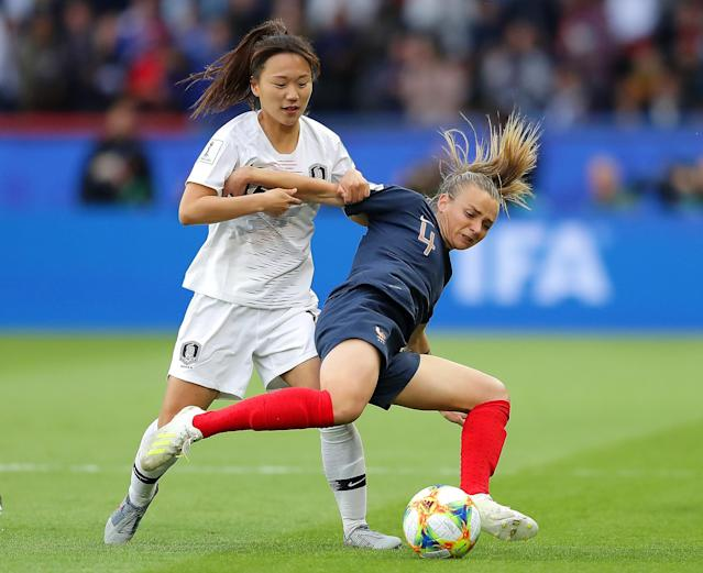Marion Torrent of France battles for possession with Selgi Jang of Korea Republic during the 2019 FIFA Women's World Cup France group A match between France and Korea Republic at Parc des Princes on June 07, 2019 in Paris, France. (Photo by Richard Heathcote/Getty Images)