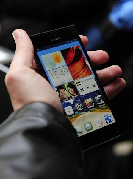 A man holds Huawei's new smartphone, Ascend P2, after a press conference in Barcelona on February 24, 2013. Huawei said it can achieve speeds of 150 Mbps, fast enough to download a two-hour high-definition movie in less than five minutes