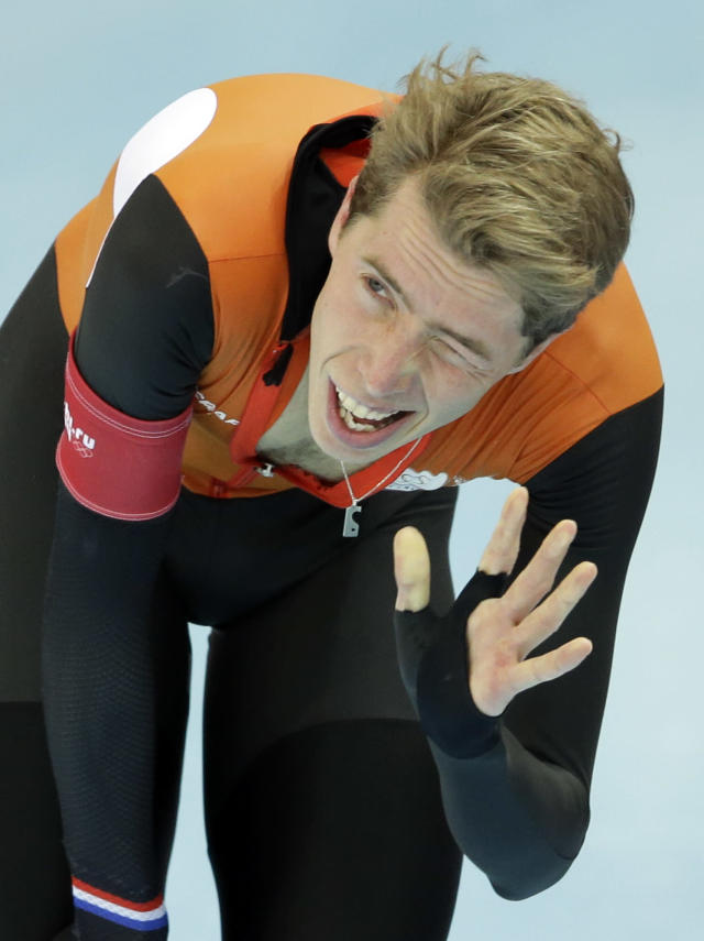 Jorrit Bergsma of the Netherlands winks to acknowledge the crowd after setting a new world record in the men's 10,000-meter speedskating race at the Adler Arena Skating Center during the 2014 Winter Olympics in Sochi, Russia, Tuesday, Feb. 18, 2014. (AP Photo/Patrick Semansky)