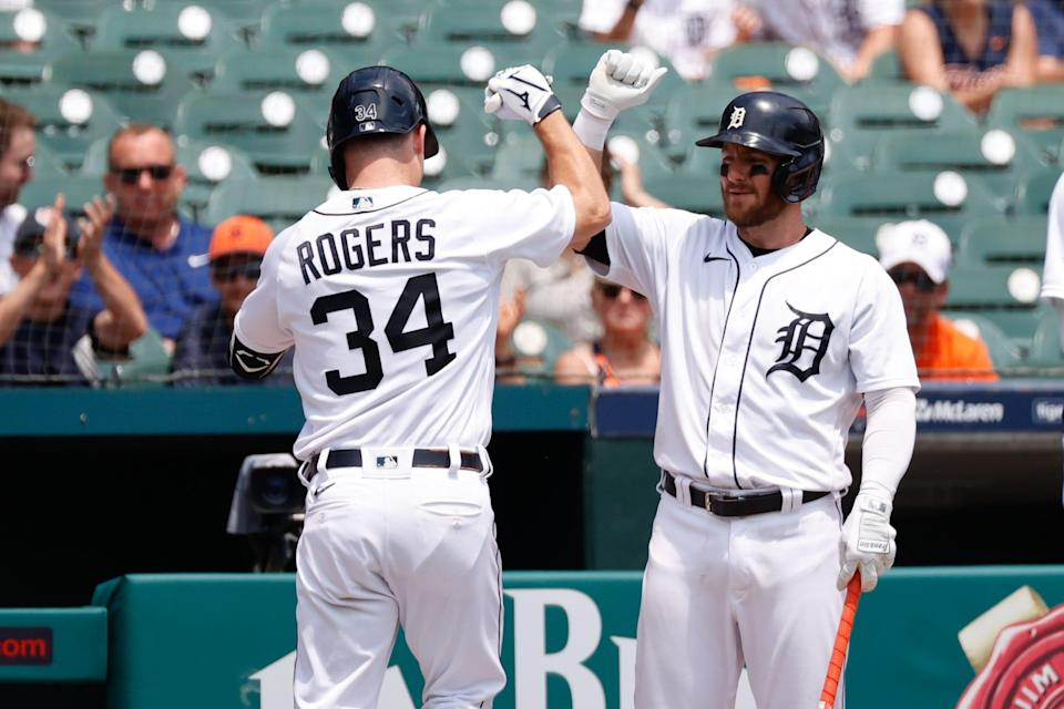 Detroit Tigers catcher Jake Rogers (34) receives congratulations from left fielder Robbie Grossman (8) after he hits a home run in the second inning  June 10, 2021 against the Seattle Mariners at Comerica Park.