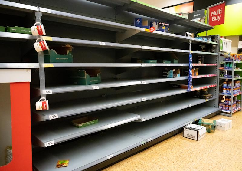 CARDIFF, UNITED KINGDOM - MARCH 06: Empty shelves where pasta was on sale in an ASDA store on March 6, 2020 in Cardiff, United Kingdom. Coronavirus (Covid-19) has spread to 88 countries in a matter of weeks, claiming nearly 3,500 lives and infecting over 100,000. There are currently 164 diagnosed cases in the UK and two deaths. (Photo by Matthew Horwood/Getty Images)