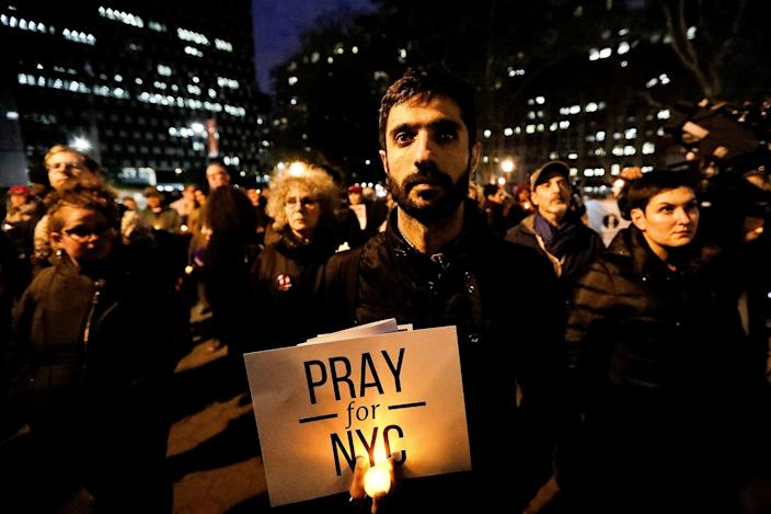 <p>NOV. 1, 2017 – People gather for a candlelight vigil for victims of the pickup truck attack at Foley Square in New York City. (Photo: Jeenah Moon/Reuters) </p>