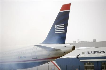 A US Airways plane emits exhaust at Philadelphia International Airport