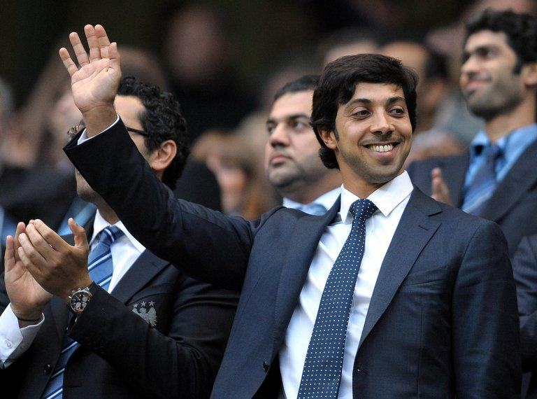 Sheikh Mansour bin Zayed Al Nahyan (C) looks on during an English Premier League football match, August 23, 2010