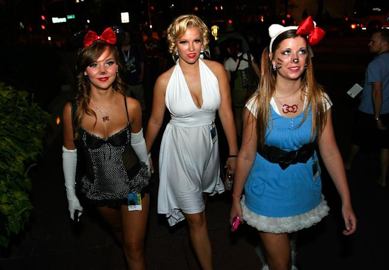 Three women make their way to the evening festivities at Dragon Con in Atlanta, on Friday, Aug. 31, 2012. The annual science fiction and fantasy convention drew big crowds and had more than 30,000 pre-registered attendees. (AP Photo/Ron Harris)