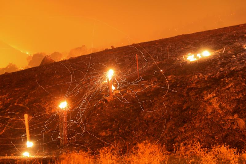 Flying embers from a destroyed fence are seen during the Kincade fire near Geyserville, California, U.S. October 24, 2019. (Photo: Stephen Lam/Reuters)