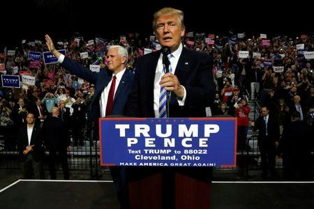 Republican U.S. presidential nominee Donald Trump (R) and vice presidential candidate Mike Pence (L) hold a campaign rally in Cleveland, Ohio, U.S. October 22, 2016. REUTERS/Jonathan Ernst