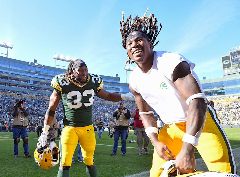 GREEN BAY, WISCONSIN - OCTOBER 20: Aaron Jones #33 of the Green Bay Packers and Jamaal Williams #30 of the Green Bay Packers celebrate after the game against the Oakland Raiders at Lambeau Field on October 20, 2019 in Green Bay, Wisconsin. (Photo by Quinn Harris/Getty Images)