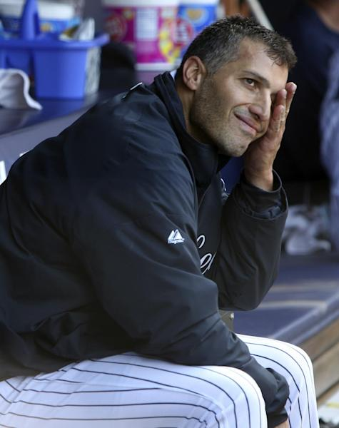 New York Yankees starting pitcher Andy Pettitte wipes his face while sitting in the dugout after being removed during the seventh inning of a baseball game against the Seattle Mariners at Yankee Stadium in New York, Sunday, May 13, 2012. (AP Photo/Seth Wenig)