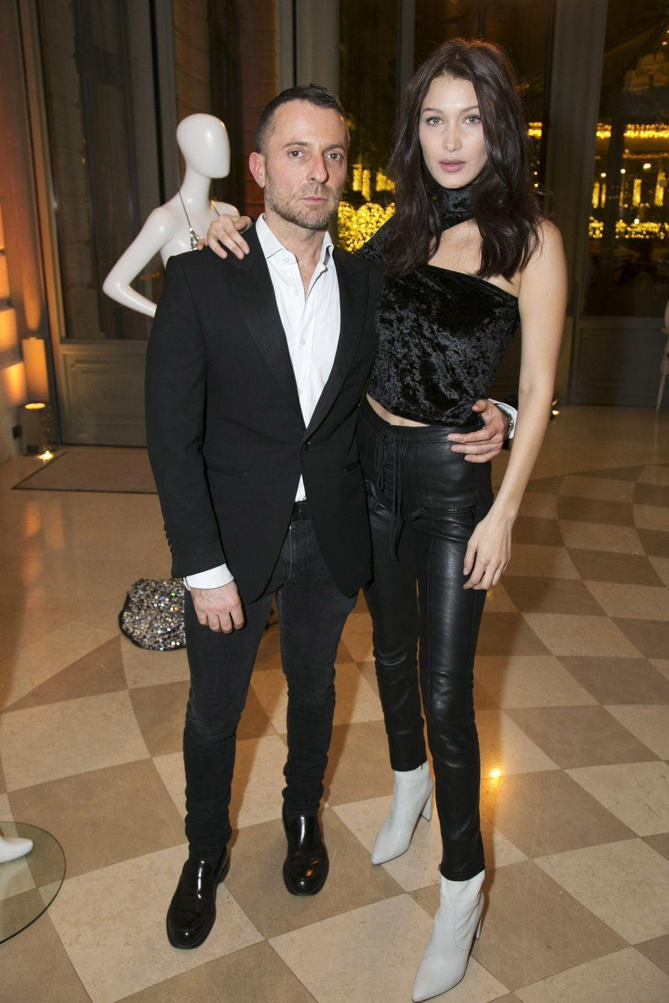 <p>In an Off-White velvet asymmetrical top, leather pants and white boots at a cocktail and dinner with Alexandre Vauthier at the Hotel Ritz in Paris.</p>