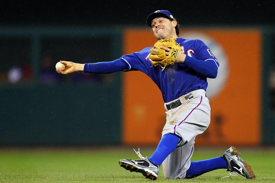 ST LOUIS, MO - OCTOBER 19: Ian Kinsler #5 of the Texas Rangers fields a ball in the eighth inning during Game One of the MLB World Series against the St. Louis Cardinals at Busch Stadium on October 19, 2011 in St Louis, Missouri. (Photo by Dilip Vishwanat/Getty Images)