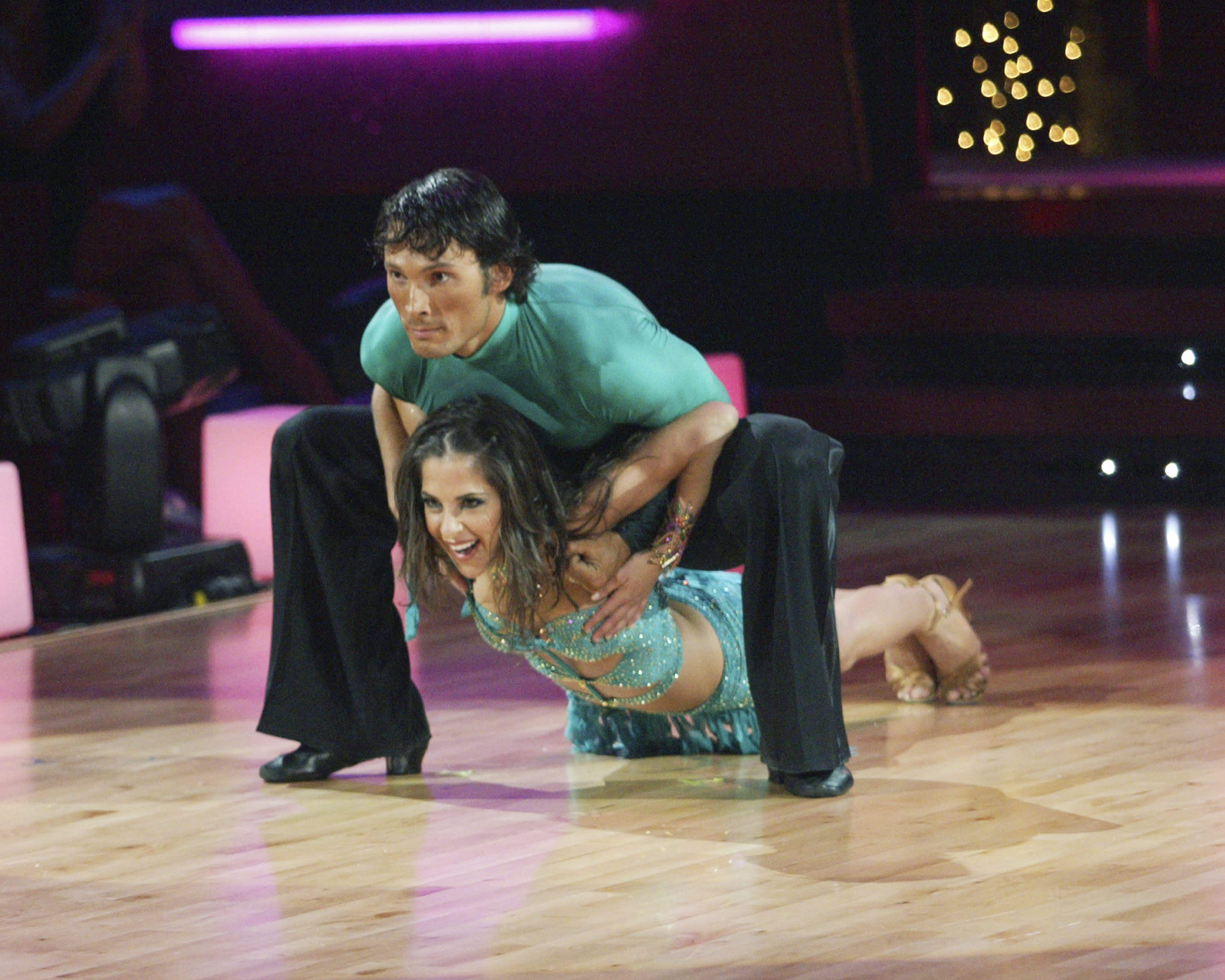 Kelly Monaco holds onto her top as she nails a dance move. (Photo by Adam Larkey/Walt Disney Television via Getty Images)
