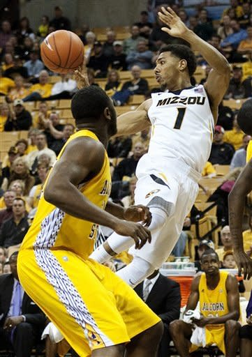 Missouri's Phil Pressey (1) passes the ball past Alcorn State's Jamaal Hester, left, as he drives to the basket during the first half of an NCAA college basketball game, Tuesday, Nov. 13, 2012, in Columbia, Mo. Pressey led all scorers with 21 points in Missouri's 91-54 victory. (AP Photo/L.G. Patterson)