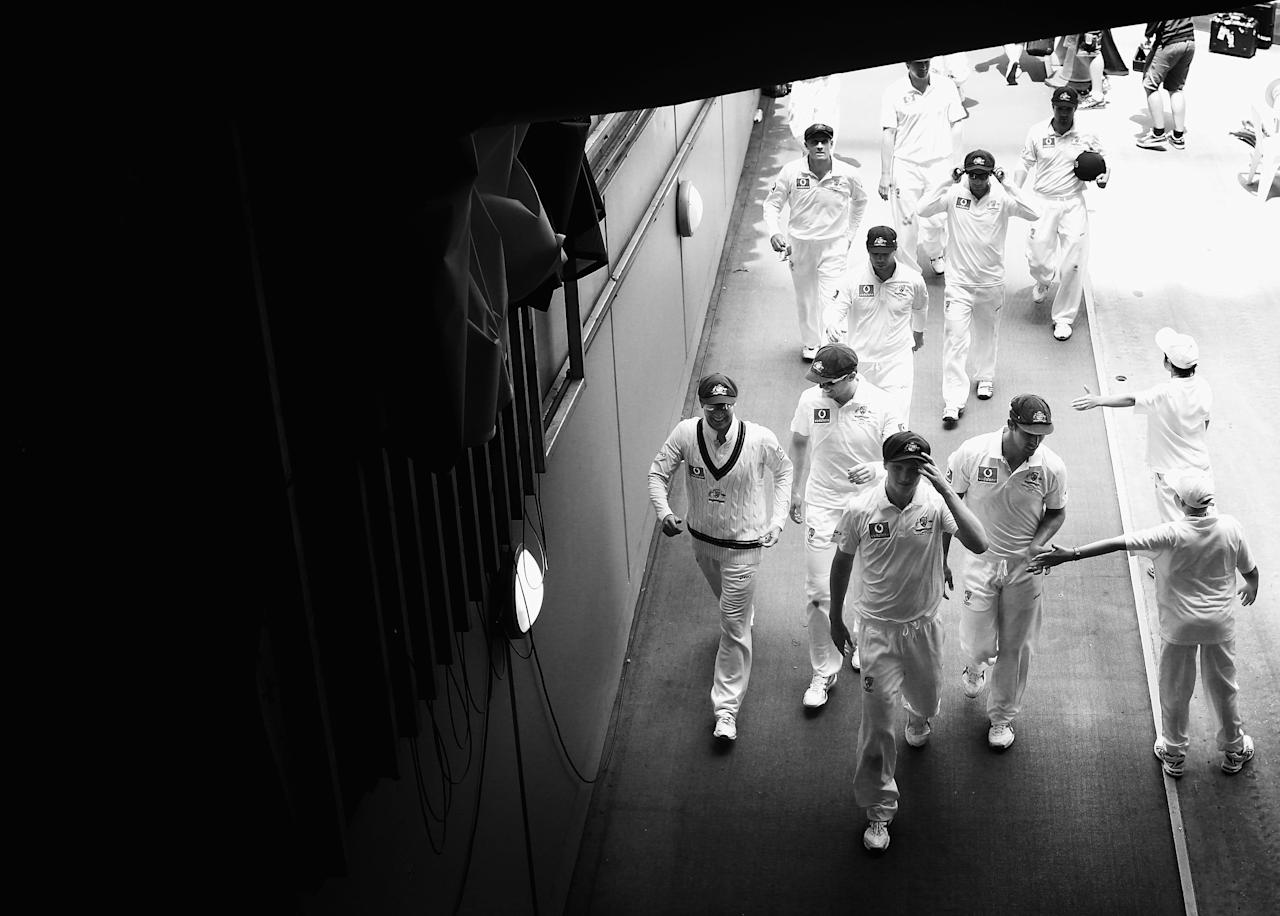 MELBOURNE, AUSTRALIA - DECEMBER 26: (EDITORS NOTE: Image has been converted to black and white.) Jackson Bird of Australia leads the team from the field after they bowled Sri Lanka out during day one of the Second Test match between Australia and Sri Lanka at the Melbourne Cricket Ground on December 26, 2012 in Melbourne, Australia.  (Photo by Ryan Pierse/Getty Images)