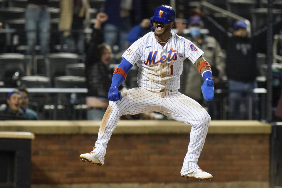 New York Mets' Jonathan Villar celebrates after scoring during the ninth inning of the team's baseball game against the Baltimore Orioles on Tuesday, May 11, 2021, in New York. The Mets won 3-2. (AP Photo/Frank Franklin II)