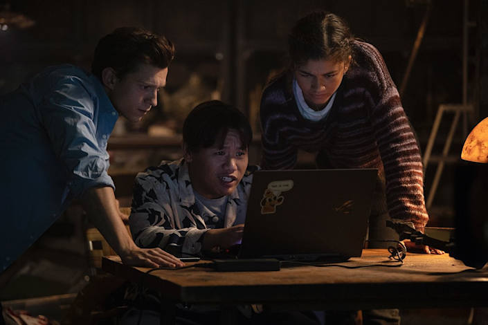 Peter, Ned, and MJ look at a computer