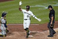 Pittsburgh Pirates' Rodolfo Castro (64) celebrates as he crosses home plate after hitting a solo home run off Milwaukee Brewers relief pitcher Eric Lauer during the seventh inning of a baseball game in Pittsburgh, Wednesday, July 28, 2021. (AP Photo/Gene J. Puskar)