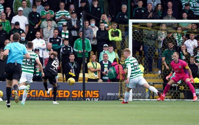 Livingston's Andrew Shinnie scores the only goal of the game against Celtic in the cinch Premiership