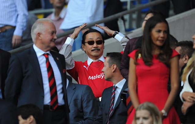 CARDIFF, WALES - AUGUST 25: Cardiff City owner Tan Sri Dr Vincent Tan (c) reacts before the Barclays Premier League match between Cardiff City and Manchester City at Cardiff City Stadium on August 25, 2013 in Cardiff, Wales. (Photo by Stu Forster/Getty Images)