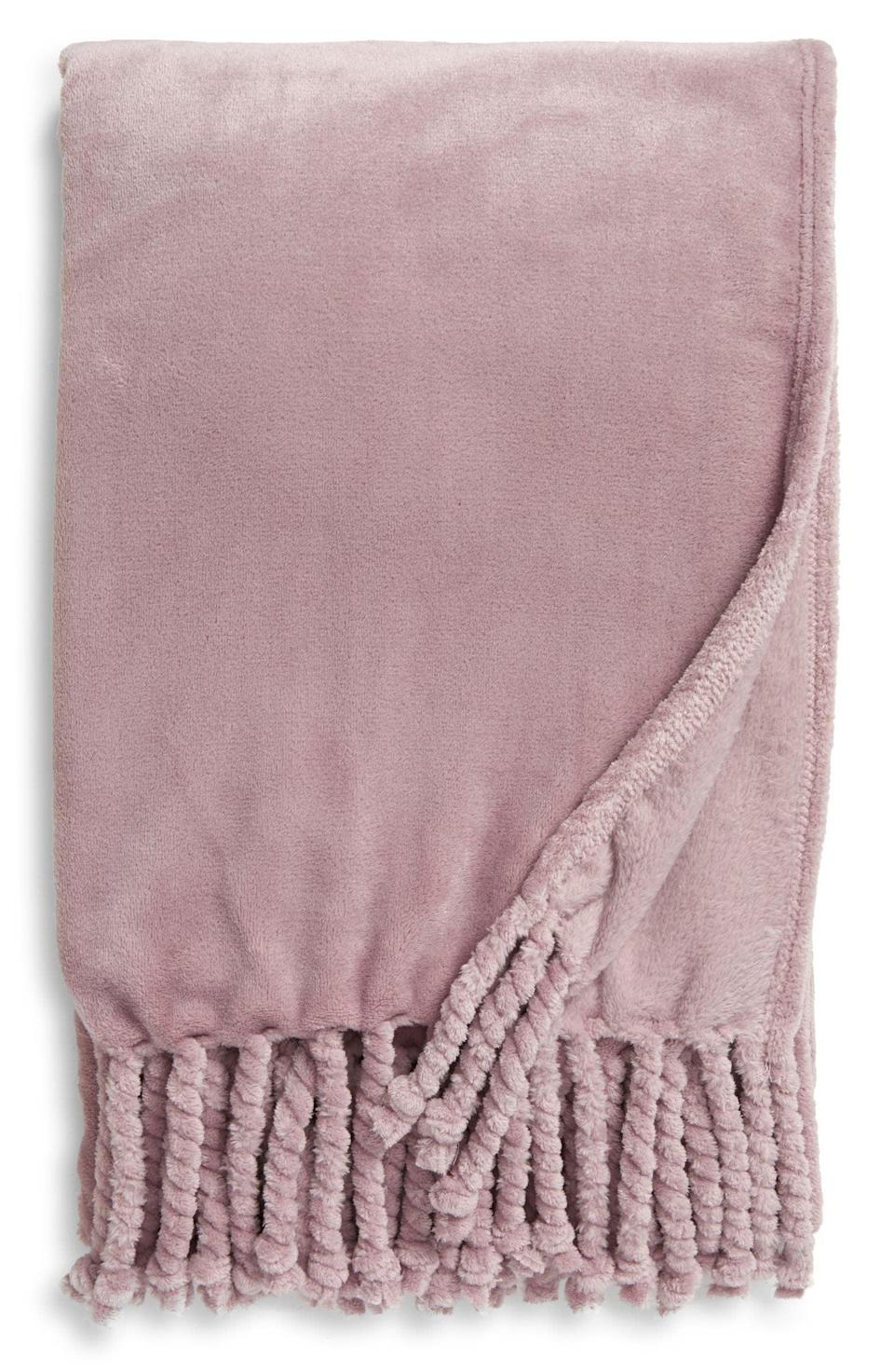 <p>Get them this stunning <span>Nordstrom Bliss Plush Throw</span> ($40) that looks so luxe and comes in a ton of colors. It's something they'll cuddle with all the time. </p>