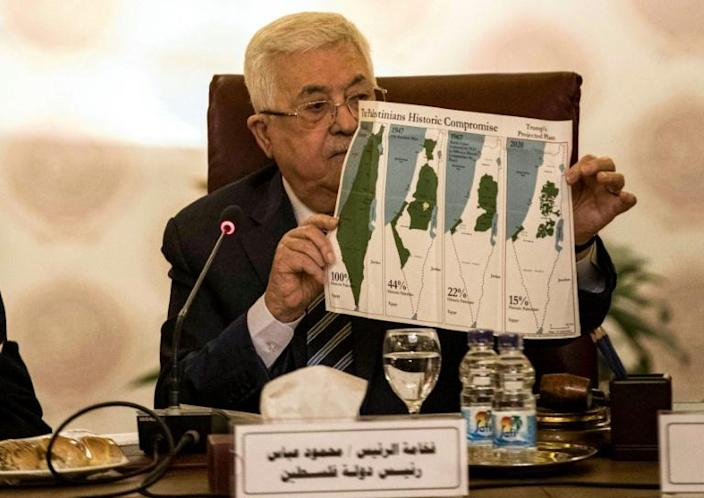 Palestinian president Mahmud Abbas shows maps of historical Palestine during a February 2020 Arab League meeting on President Donald Trump's proposed Middle East plan (AFP Photo/Khaled DESOUKI)