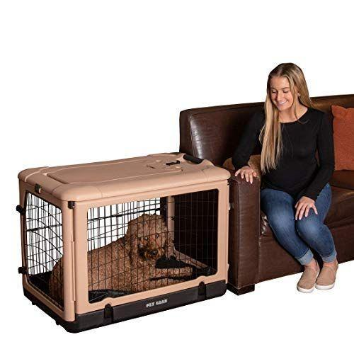 """<p><strong>Pet Gear</strong></p><p>amazon.com</p><p><strong>$234.54</strong></p><p><a href=""""https://www.amazon.com/dp/B0015MG0E2?tag=syn-yahoo-20&ascsubtag=%5Bartid%7C10055.g.34726230%5Bsrc%7Cyahoo-us"""" rel=""""nofollow noopener"""" target=""""_blank"""" data-ylk=""""slk:Shop Now"""" class=""""link rapid-noclick-resp"""">Shop Now</a></p><p>Split the difference between a plastic and metal dog crate with this sturdy one. It's sturdy and sets up without any tools, with four doors for easy access, including a top lift-out one that could be useful for smaller pups. This crate also includes a plush bed inside, so you won't need to purchase one separately. </p>"""