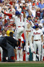 Philadelphia Phillies' Maikel Franco (7) and Cesar Hernandez celebrate after Franco's two-run home run off Atlanta Braves starting pitcher Bryse Wilson during the fourth inning of a baseball game, Saturday, March 30, 2019, in Philadelphia. (AP Photo/Matt Slocum)