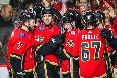 Jan 11, 2019; Calgary, Alberta, CAN; Calgary Flames left wing Matthew Tkachuk (19) celebrates his goal with teammates against the Florida Panthers during the third period at Scotiabank Saddledome. Calgary Flames won 4-3. Mandatory Credit: Sergei Belski-USA TODAY Sports