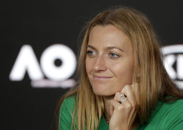 Petra Kvitova of the Czech Republic answers questions at a press conference at the Australian Open tennis championships in Melbourne, Australia, Friday, Jan. 25, 2019. Kvitova will play Japan's Naomi Osaka in Saturday's women's final. (AP Photo/Kin Cheung)
