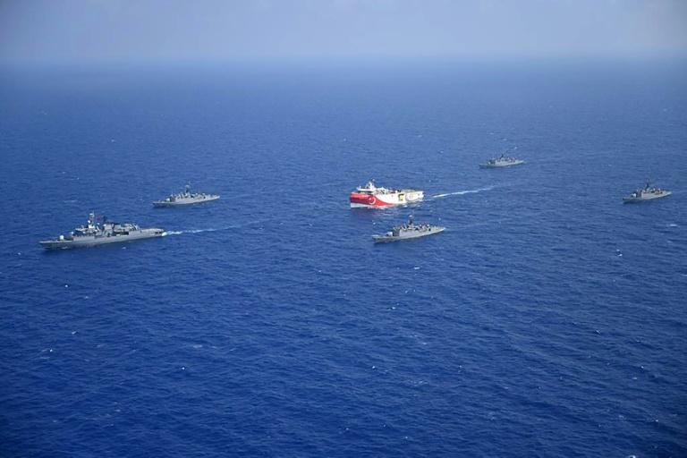 The Turkish Oruc Reis research ship, accompanied by a small navy fleet, sails into disputed Mediterranean waters