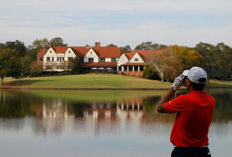 A golfer checks the distance on a hole at East Lake Golf Club in Atlanta, with such technology being among the items studied in a now-delayed report by global governing bodies