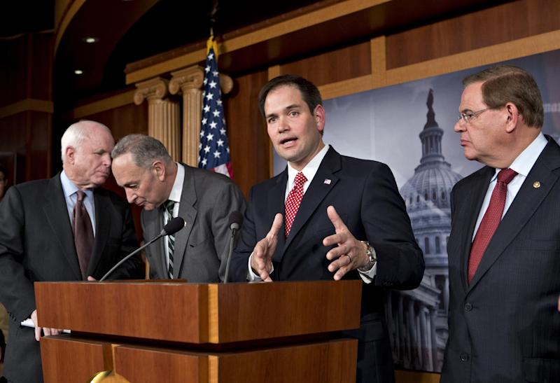 "FILE – In this Jan. 28, 2013, file photo Sen. Marco Rubio, R-Fla., center, speaks at a Capitol Hill news conference on immigration legislation with a members of a bipartisan group of leading senators, including, from left, Sen. John McCain, R-Ariz., Sen. Chuck Schumer, D-N.Y. and Sen. Robert Menendez, D-N.J., in Washington. After months of arduous closed-door negotiations, the ""Gang of Eight"" senators equally divided between the two parties had no issues left to resolve in person, and no more negotiating sessions were planned. Remaining details were left to aides, who were at work completing drafts of the bill. (AP Photo/J. Scott Applewhite, File)"