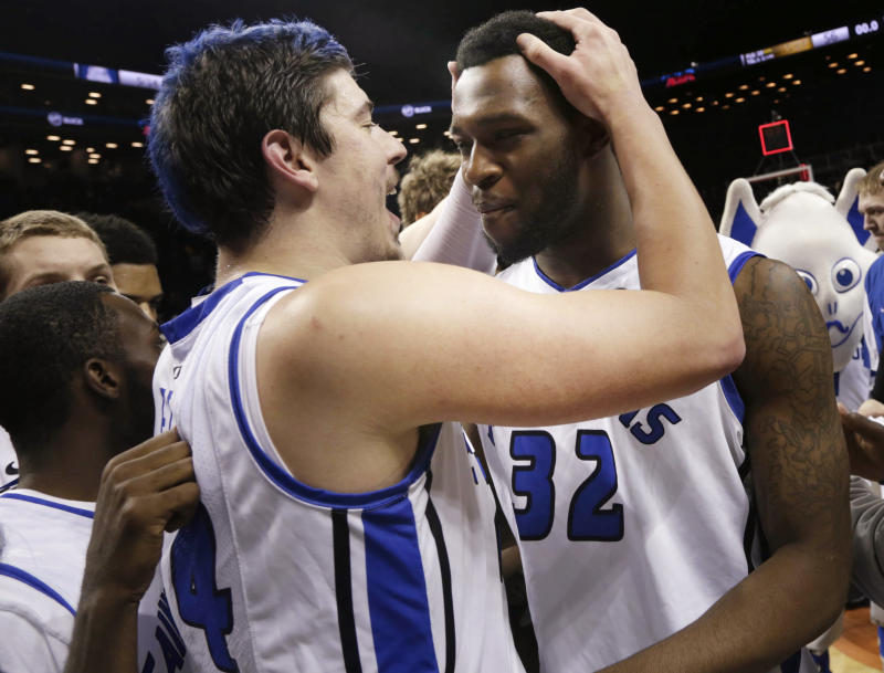 Saint Louis' Cody Ellis, left, celebrates with Cory Remekun after the NCAA college basketball game against the Virginia Commonwealth in the championships of the Atlantic 10 Conference tournament, Sunday  March 17, 2013, in New York. Saint Louis beat Virginia Commonwealth 62-56.  (AP Photo/Seth Wenig)
