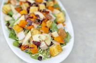 """<p><strong>Recipe: <a href=""""https://www.southernliving.com/syndication/festive-fall-salad"""" rel=""""nofollow noopener"""" target=""""_blank"""" data-ylk=""""slk:Festive Fall Salad"""" class=""""link rapid-noclick-resp"""">Festive Fall Salad </a></strong></p> <p>Packed with creamy butternut squash and topped with crunchy cornbread croutons, this Festive Fall Salad recipe welcomes the season with all the signature flavors. Brussels sprouts and spinach add body, and roasted turkey breast turns it into a delicious meal.</p>"""