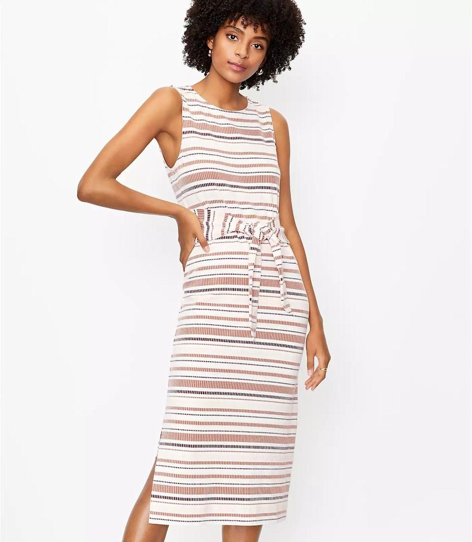 <p>This <span>Loft Striped Tie Waist Midi Dress</span> ($80) looks summery and fresh, perfect for a cruise or al fresco dinner. But you can wear it well into the fall with the addition of a tan peacoat and tall boots.</p>