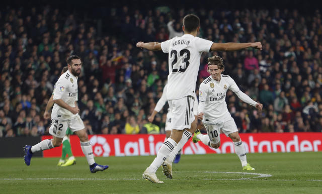 Real Madrid's Modric, right, celebrates after scoring against Betis during La Liga soccer match between Betis and Real Madrid at the Villamarin stadium in Seville, Spain, Sunday, January 13, 2019. (AP Photo/Miguel Morenatti)