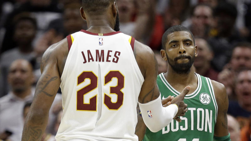a388a8b33ca Kyrie Irving and LeBron James share a moment after their first meeting  since parting ways. (AP)