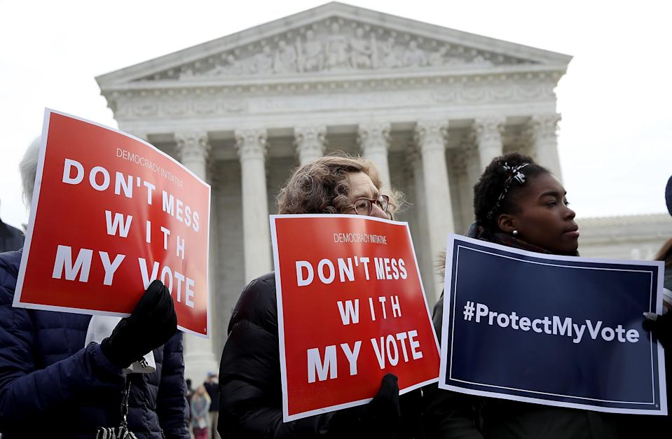 Protesters gather in front of the Supreme Court in 2018, rallying against voter roll purges.