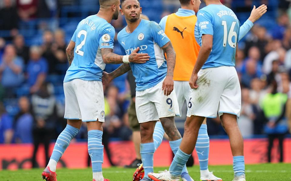 Gabriel Jesus and Kyle Walker of Manchester City celebrate their team's victory in the Premier League match between Chelsea and Manchester City. - Matt McNulty - Manchester City/Manchester City FC via Getty Images