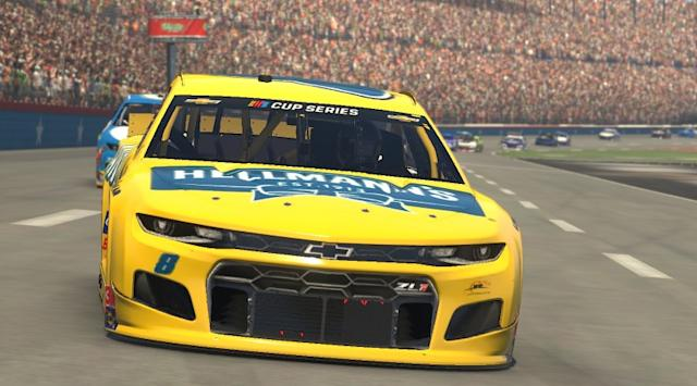 """Dale Earnhardt Jr. competes in the eNASCAR event at virtual Texas Motor Speedway on March 29. The race, covered by Fox Sports, drew more than 1.3 million viewers. <span class=""""copyright"""">(Chris Graythen / Getty Images)</span>"""