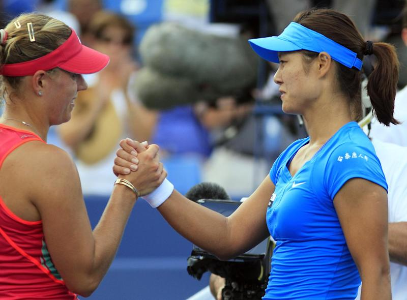 Angelique Kerber, of Germany, congratulates Li Na, of China, after the women's final at the Western & Southern Open tennis tournament, Sunday, Aug. 19, 2012, in Mason, Ohio. Na won 1-6, 6-3, 6-1. (AP Photo/Al Behrman)