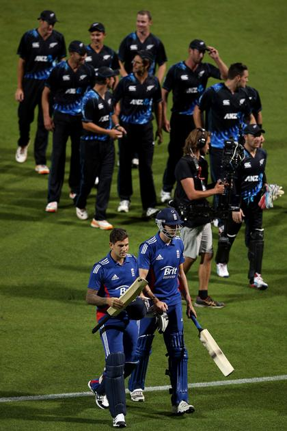 HAMILTON, NEW ZEALAND - FEBRUARY 12: Jade Dernbach and Steven Finn of England walk off after losing the international Twenty20 match between New Zealand and England at Seddon Park on February 12, 2013 in Hamilton, New Zealand.  (Photo by Hannah Johnston/Getty Images)