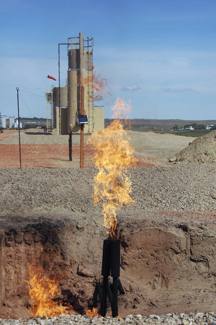 FILE - In this Sept. 23, 2008 file photo, natural gas is flared from an oil well near Parshall, N.D. The North Dakota Industrial Commission is holding a hearing in Bismarck on Tuesday, April 22, 2014, on its new natural gas flaring policy that's intended to cut back on the amount of natural gas burned off and wasted as a byproduct of natural gas production. The percentage of gas being flared in the state is pegged at a record 36 percent. (AP Photo/James MacPherson, File)