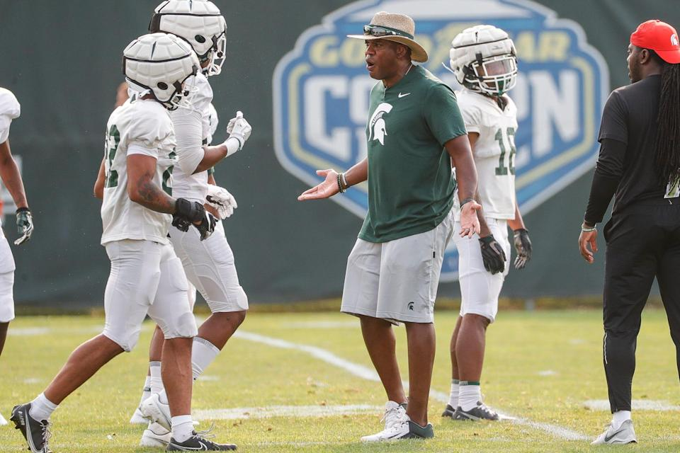 Michigan State head coach Mel Tucker talks to players during practice Wednesday, Aug. 11, 2021 at the team's facility in East Lansing.