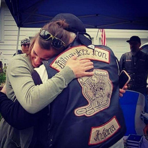 PHOTO: Daryn Sturch of Denver, Indiana, exchanges hugs with a member of the Milwaukee Iron motorcyle group, whom she helped after a motorcycle crash in 2018. (Mary Henry)
