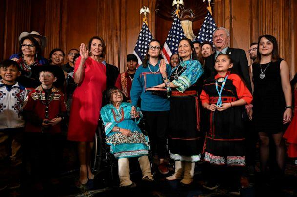 PHOTO: House Speaker Nancy Pelosi poses during a ceremonial swearing-in with Rep. Deb Haaland, on Capitol Hill, Jan. 3, 2019. (Susan Walsh/AP, FILE)