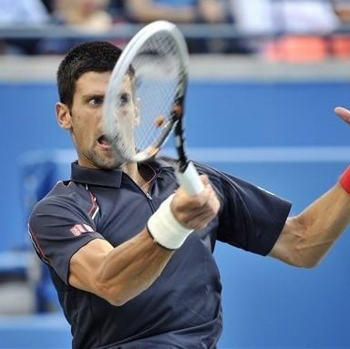 Novak Djokovic, of Serbia, returns the ball against Richard Gasquet, of France, during their match at the Rogers Cup men's tennis tournament, Sunday, Aug. 12, 2012, in Toronto. (AP Photo/The Canadian Press, Nathan Denette)