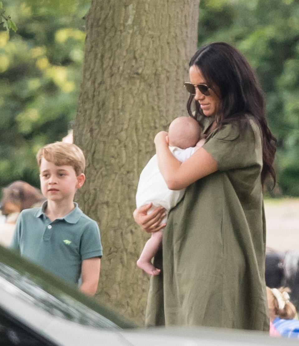 Prince George with Meghan, Duchess of Sussex and Archie Mountbatten-Windsor. (Photo by Samir Hussein/WireImage)